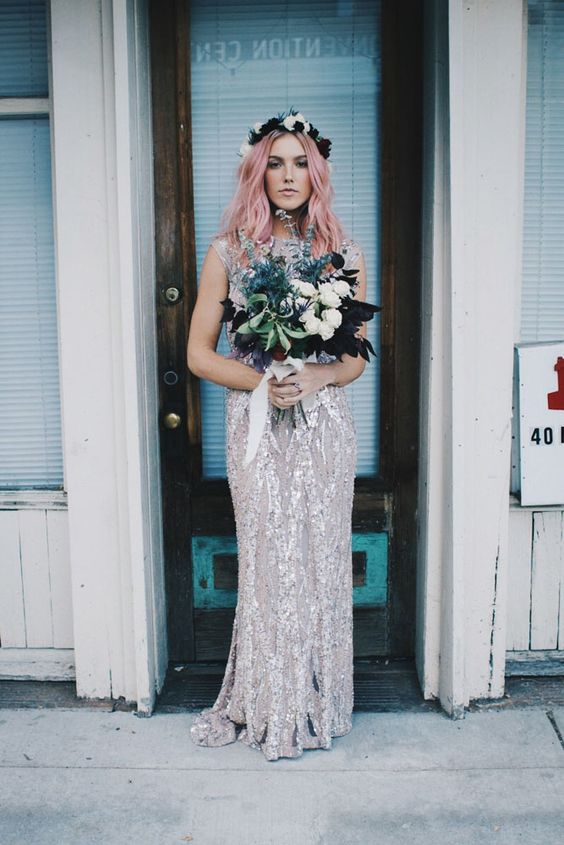 a sparkling silver sheath wedding dress with a small train, a high neckline and cap sleeves plus a floral crown for a celestial look