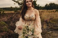 a strapless nude A-line wedding dress with puff sleeves, gold and silver foil stars and a fully embellished bodice for a gorgeous celestial wedding