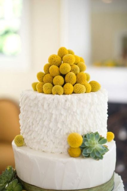 a white buttercream wedding cake with billy balls and succulents is a lovely idea for a spring or summer wedding