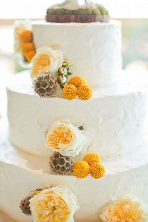 a white textural buttercream wedding cake with neutral blooms, billy balls and seed pods is a stylish idea for spring or summer