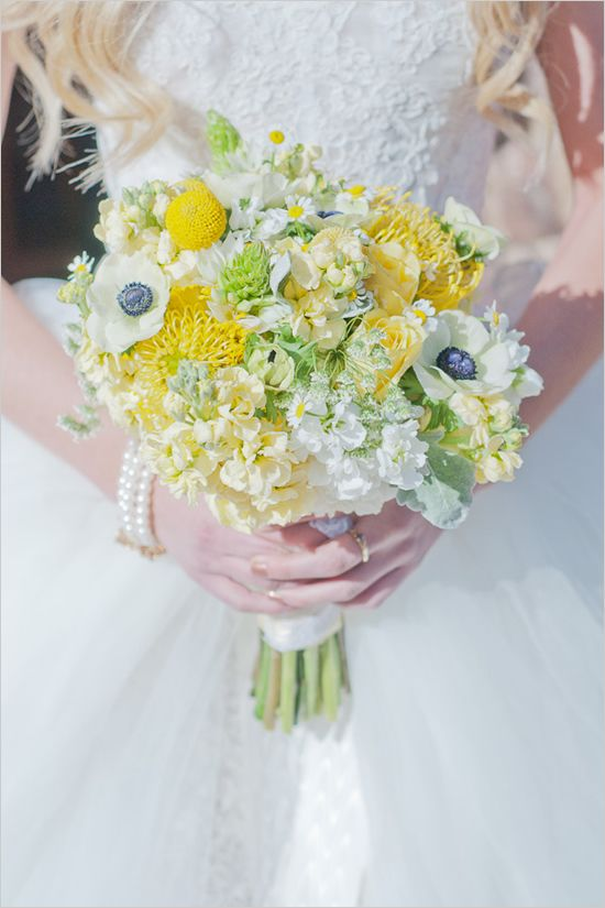 a yellow wedding bouquet with yellow and white blooms, billy balls and some greenery is a pretty idea for a spring or summer bride