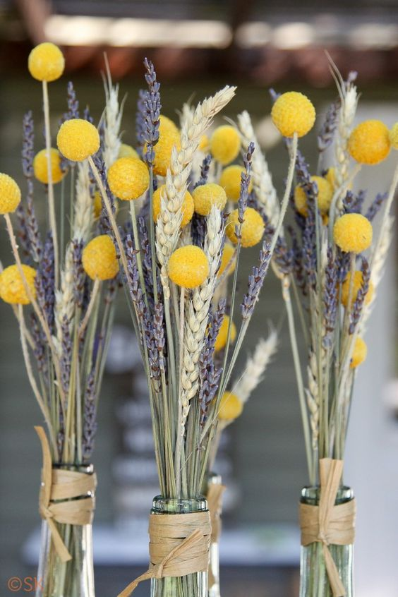cool rustic wedding centerpiece of wheat, lavender and billy balls are perfect for rustic summer or fall wedding