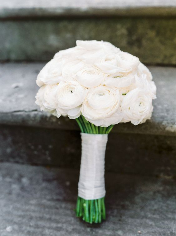 a classic white ranunculus wedding bouquet with a matching wrap is a stylish and absolutely timeless idea to rock