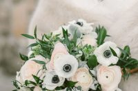 02 a subtle wedding bouquet of white anemones and blush ranunculus, greenery and pale leaves is a very chic idea