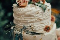 03 a charming secret garden wedding cake with textural buttercream, gold foil, fresh pink blooms and greenery is chic