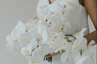 03 a classic and sophisticated cascading white orchid wedding bouquet is a lovely idea for a refined modern bride or for a tropical one