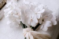 04 a chic one flower wedding bouquet in white, with neutral ribbons is a lovely idea for a modern and refined wedding
