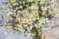 04 a relaxed summer wedding bouquet of baby's breath, lavender, daisies with a simple wrap is a very cool and fun idea
