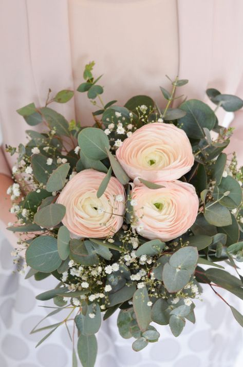 a lovely wedding bouquet of blush ranunculus, eucalyptus and baby's breath is a stylish and beautiful idea for a spring or summer bride