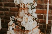 06 a chic secret garden wedding cake with geometric tiers, white blooms, caramel drip is a fantastic idea for summer or fall