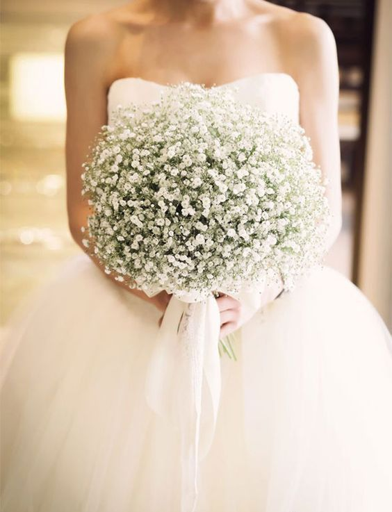 a dreamy wedding bouquet composed of only baby's breath and white ribbons is a very chic and very romantic idea