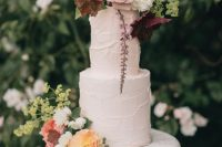 07 a fabulous secret garden wedding cake with textural buttercream, pastel blooms and greenery on top is a lovely idea