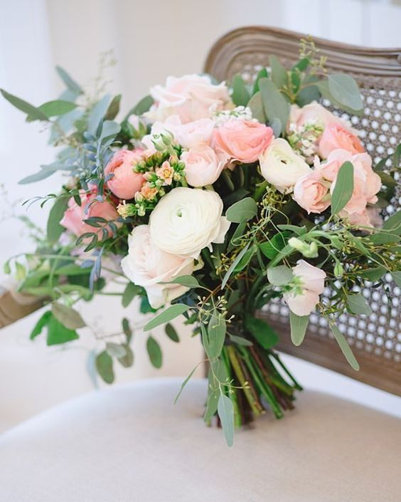 a lovely wedding bouquet of white and pink ranunculus, greenery is a chic and lovely idea for a romantic wedding