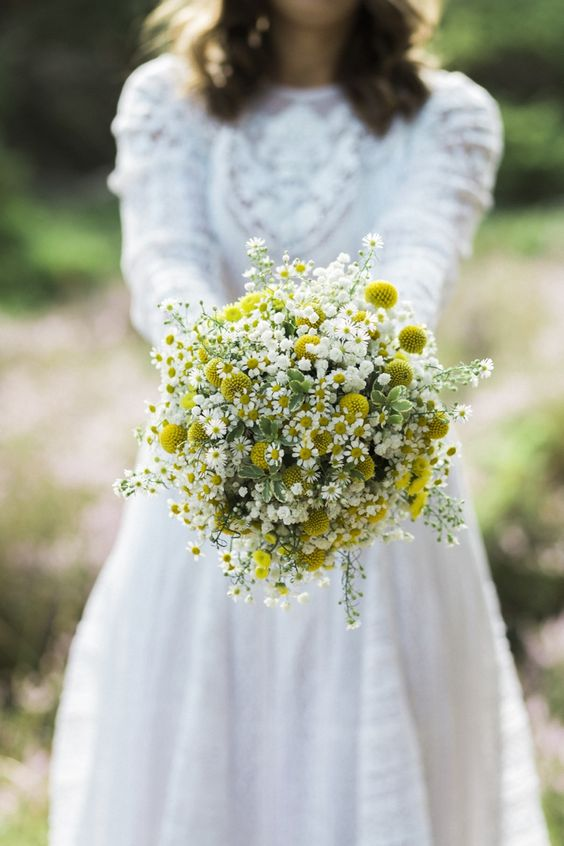 a beautiful billy ball, daisies and baby's breath wedding bouquet will be amazing for a mid-century modern, boho or wildflower summer wedding