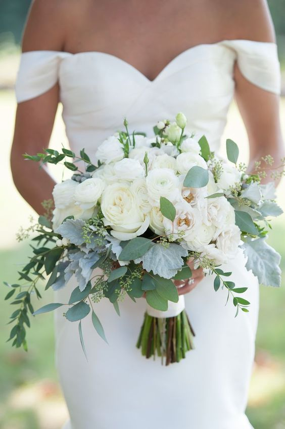 a classic wedding bouquet composed of white ranunculus and some pale foliage is a lovely idea for a modern neutral wedding