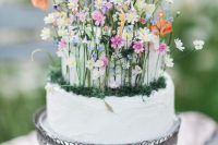 09 a fantastic wedding cake in white, with tiny colorful flowers, moss and foliage is a lovely idea for a secret garden wedding