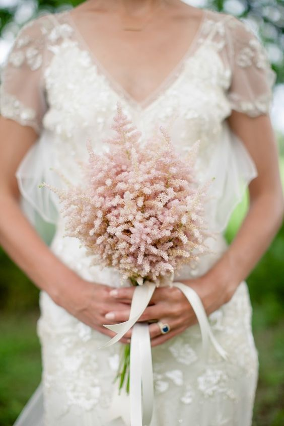 a lovely astilbe wedding bouquet is a pretty addition to your wedding look and will bring a bit of color