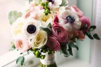 11 a cool wedding bouquet of pink, bold pink and white ranunculus, white anemones and pale foliage is very romantic