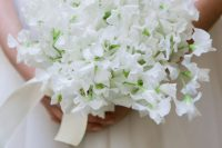 11 a lovely white sweet pea wedding bouquet with ribbons is a gorgeously ethereal idea for a spring bride