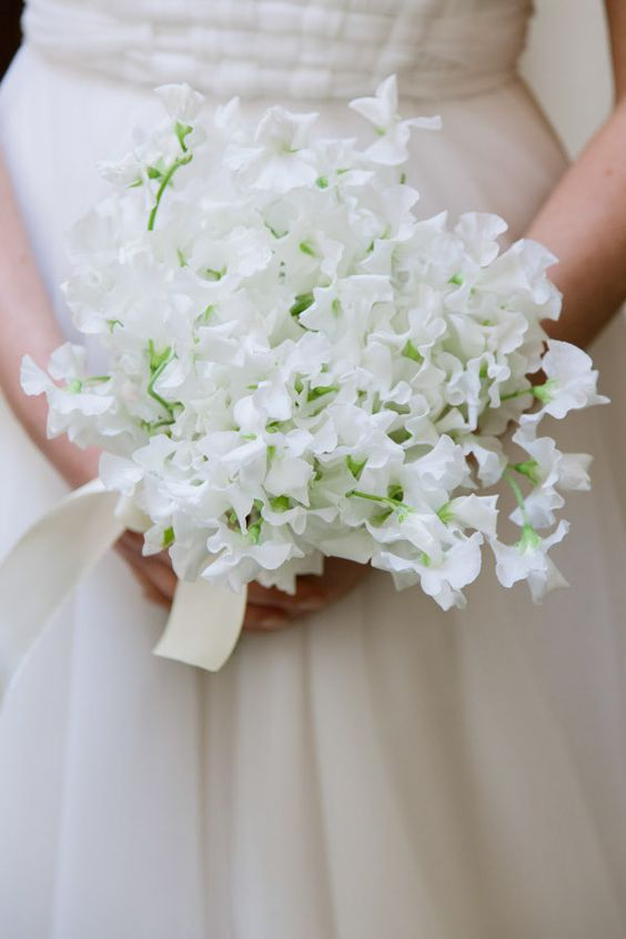 a lovely white sweet pea wedding bouquet with ribbons is a gorgeously ethereal idea for a spring bride