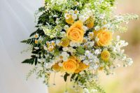 12 a bright and chic wedding bouquet that includes yellow roses, billy balls, daisies, ferns and greenery for a summer wedding