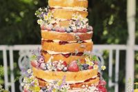 12 a naked secret garden wedding cake decorated with bold blooms and fresh berries is a very chic and delicious-looking idea