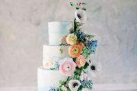 13 a refined secret garden wedding cake with textural blue buttercream and pastel detailing, pastel blooms and greenery