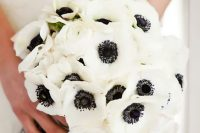 13 a white anemon wedding bouquet wiht a black and white wrap is a cool idea for a classic black and white wedding