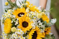 a bright rustic wedding bouquet with sunflowers, billy balls, daisies, greenery is a very summer-like and fun idea to try