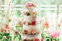 14 a romantic secret garden wedding cake – a naked one with bold blooms and colorful macarons plus pink ribbons is wow