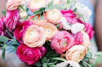 15 a beautiful and colorful ranunculus wedding bouquet with hot pink and orange blooms, white anemones and greenery
