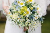 15 a midsummer wedding bouquet with daisies, blue blooms and yellow mimosas, grass is a very lovely and relaxed arrangement