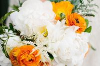 16 a bold wedding bouquet with white peonies, orange ranunculus, greenery, astilbe is a fresh and cool bouquet for summer