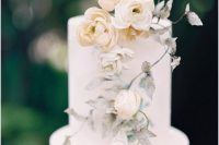 16 a subtle wedding cake in white, with neutral blooms and spray painted leaves is a very chic and beautiful idea for a secret garden wedding