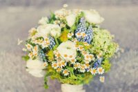 17 a pretty summer wedding bouquet with daisies, blue blooms and white ranunculus, some greenery is a lovely rustic summer idea