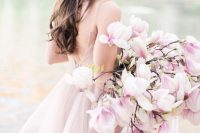 17 a super romantic and chic pink one flower wedding bouquet is a gorgeous solution for a spring bride