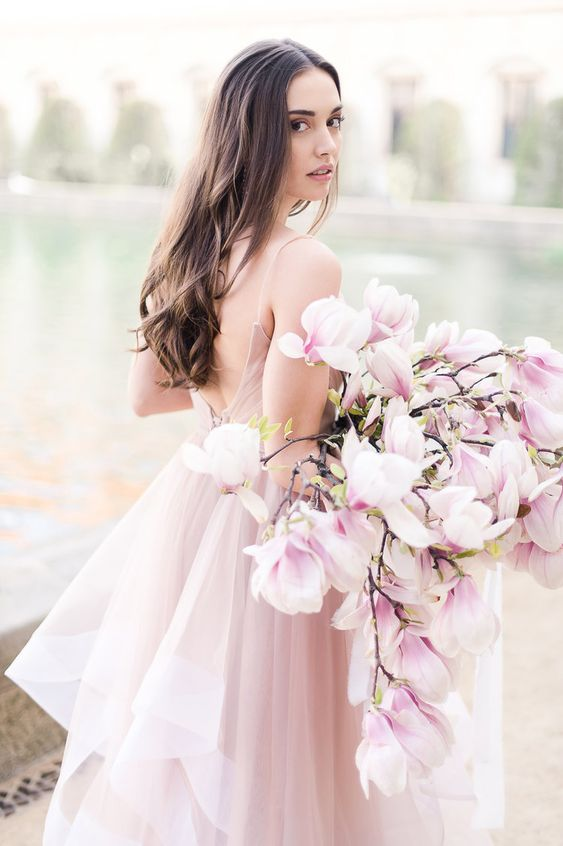 a super romantic and chic pink one flower wedding bouquet is a gorgeous solution for a spring bride