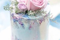 17 a very delicate and refined pastel wedding cake in light blue, with pink roses and greenery and sugar detailing is amazing for a secret garden wedding