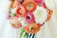 18 a bright ranunculus wedding bouquet that includes white, orange, pink blooms and striped ribbons is lovely for summer
