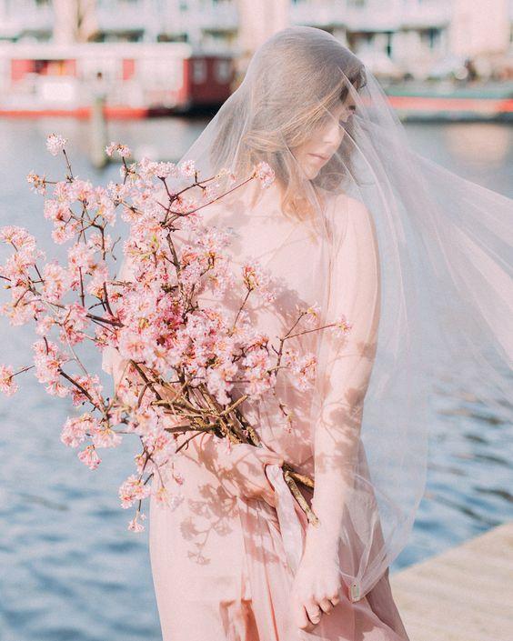 a cute cherry blossom wedding bouquet