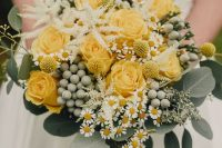 19 a bright rustic wedding bouquet with yellow roses, berries, daisies, eucalyptus, neutral blooms and billy balls is amazing