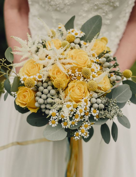 a bright rustic wedding bouquet with yellow roses, berries, daisies, eucalyptus, neutral blooms and billy balls is amazing
