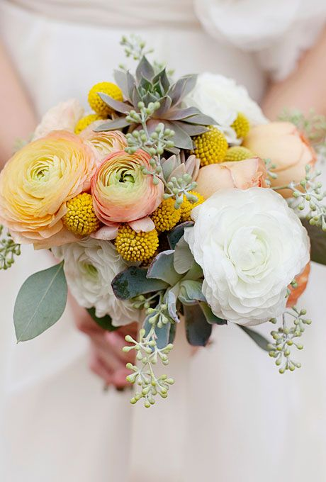 a bright wedding bouquet with yellow and white ranunculus, billy balls, greenery and succulents is ideal for spring or summer