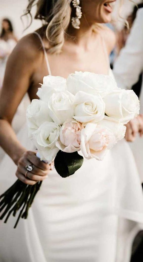 a white and blush rose wedding bouquet is a one flower combo that looks more eye catchy as it includes two different shades