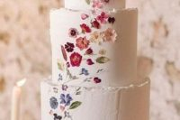 19 a white buttercream wedding cake with a raw edge and bright pressed blooms looks refined and very chic