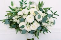 20 a beautiful and dreamy white ranunculus wedding bouquet spruced up with some eucalyptus is a chic and lovely idea