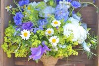 20 a bright wedding bouquet of daisies, sweet peas, ranunculus, mimosas and greenery looks wild and very creative