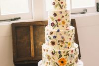 20 a gorgeous white wedding cake with lots of bright pressed blooms and leaves is a fantastic solution for a relaxed garden wedding