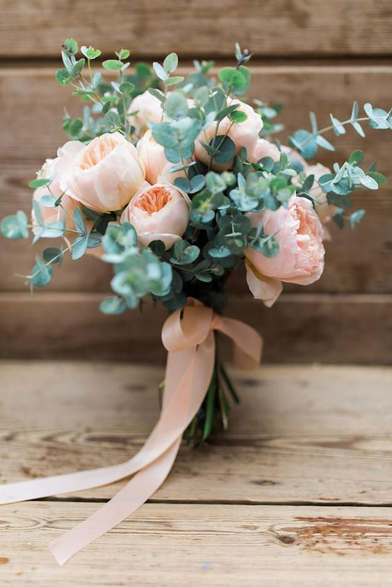 a blush peony rose wedding bouquet with eucalyptus and matching ribbons is a lovely and very girlish bouquet idea