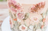 22 a delicate blush wedding cake with sugar pink blooms and foliage is a gorgeous idea for a secret garden wedding